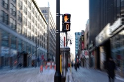 Winter Montreal, evening, people walking down the street, pedestrian traffic light with stop sign, motion, Canada