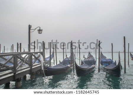 Winter morning scene group of gondolas parked at shore in venice city, Italy #1182645745