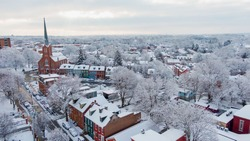 Winter morning, small American town covered in snow, idyllic landscape of colonial Lancaster, Pennsylvania after blizzard