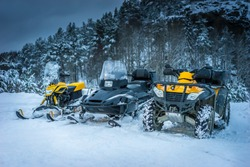 Winter Motorcycle. Snowmobile. Winter ATVs. Winter ATVs in winter against the backdrop of the mountain.