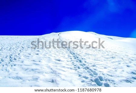 Winter mountain footprints in snow view. Footprints in mountain snow. Footprints in snow mountains. Footprints in mountain snow scene