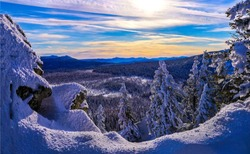 Winter mountain forest sunset view. Winter snow sunset forest panorama. Sunset winter snow mountain forest. Sunset winter snow forest in mountains
