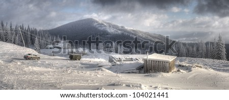 Winter mountain landscape with Christmas frozen pine-trees
