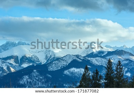 Winter mountain landscape with fir forest on slope (Slovakia, High Tatras). #171877082