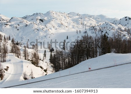 Winter mountain panorama, landscape. Ski center on top of the Vogel mountain in Slovenia. A famous ski resort in the Slovenian mountains of the Julian Alps. Snow-covered ski slope, chair lift. Europe Stockfoto ©