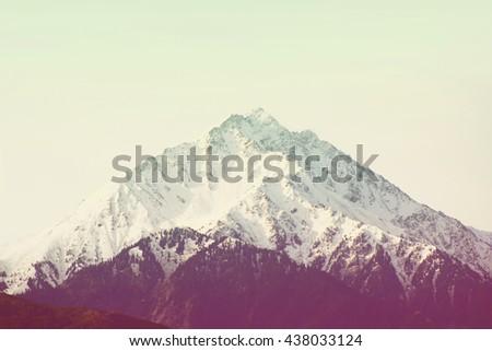Winter mountain peak, hipster vintage filter