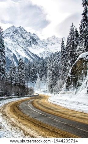 Winter mountain road snow view. Road in snowy mountains