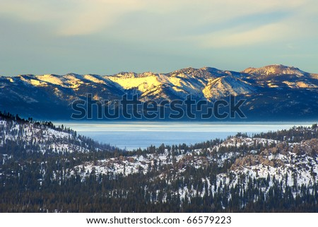 Winter mountain with lake in the trees in the foreground at Lake Tahoe, California