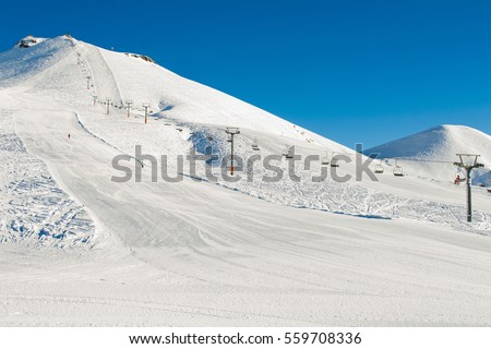 Winter mountains background with ski slopes and ski lifts. Skiing resort. Extreme sport. Active holiday. Free time concept.