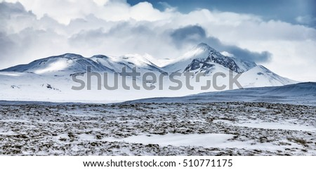 Winter mountains landscape, beautiful view on the mountains covered with snow, cold frosty weather, beauty of Iceland nature