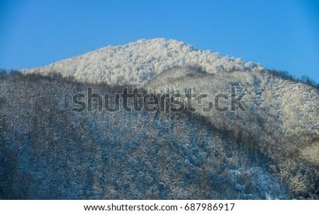 Winter mountains landscape. Mountain road. #687986917