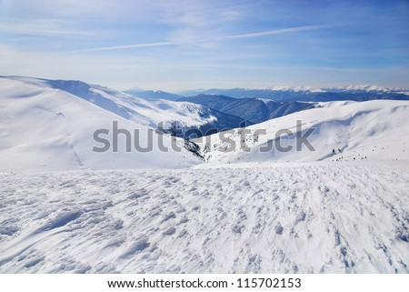 WInter mountains landscape with blue sky in summer sunny day