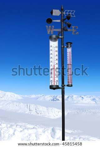 winter mountains on bright sunny day and thermometer