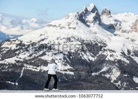 Winter mountains, panorama - snow-capped peaks of the Italian Alps. Dolomites, Alps, Italy, Trentino Alto Adige. Snow-capped mountains. Winter landscape. Panorama of snowy mountains in clouds. #1063077752