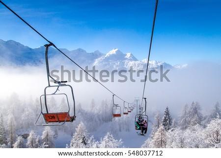 Winter mountains panorama with ski slopes and ski lifts at Vogel ski center, Slovenia. Stockfoto ©