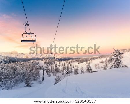 Winter mountains panorama with ski slopes and ski lifts near Vogel ski center, Slovenia #323140139