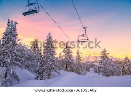 Winter mountains panorama with ski slopes and ski lifts near Vogel ski center, Slovenia #361313402