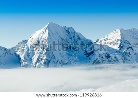 Winter mountains - ski slopes in Italian Alps