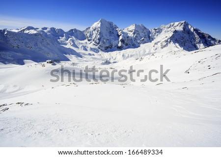 Winter mountains - ski slopes in Italian Alps #166489334