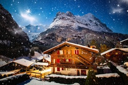 winter night Grindelwald snowy mountain, stars and wooden house
