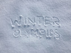 Winter Olympics - Snow Writing. Letters written on the snow surface. Frosty and sunny day.