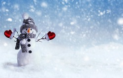 Winter or Christmas Panoramic background or banner with Happy Snowman in winter scenery. Merry Christmas and Happy New Year greeting card with copy space.