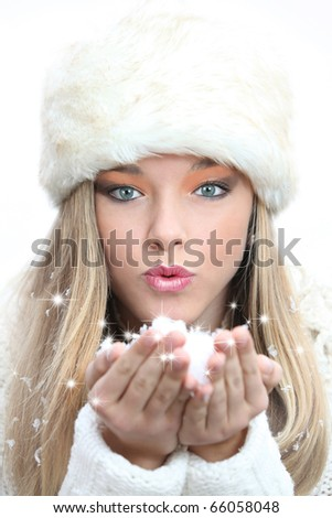 winter or christmas woman blowing fantasy snow  or snowflakes