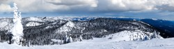 Winter panorama of Big Mountain in Whitefish, Montana, USA, with Glacier National Park in the background.