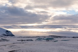 Winter Panorama of Icelandic Atlantic ocean, glacier and Vatnajökull National Park clouds