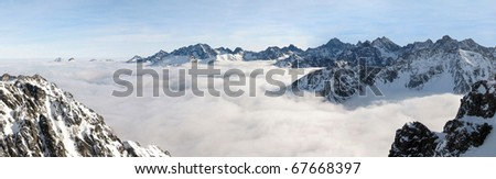 Winter panorama of mountains above the clouds. View of the High Tatras from Zadni Granat.