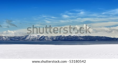 Winter panorama of Tahoe lake on a sunny day.