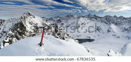 Winter panorama of the of the Tatra Mountains with ice axe. Five Lakes Valley from Maly Kozi.