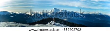 Winter panorama snow covered mountain peaks and trees in Ukrainian Carpathians, Europe. Great place for winter hiking, trekking, ski  #359402702