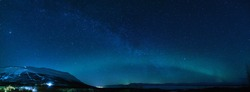 Winter panorama with Milky way and Northen lights phenomenon starting Aurora Borealis in Lapland scandinavia.