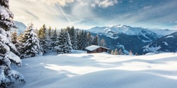 Winter panorama with ski hut in the snow