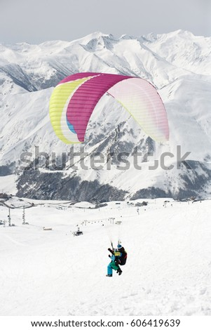 Winter paragliding in Gudauri mountains. #606419639