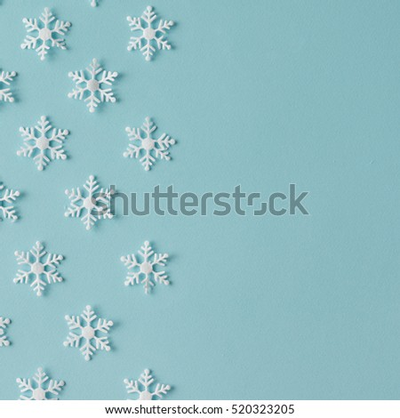 Winter pattern made of snowflakes on blue background. Winter concept. Flat lay. #520323205