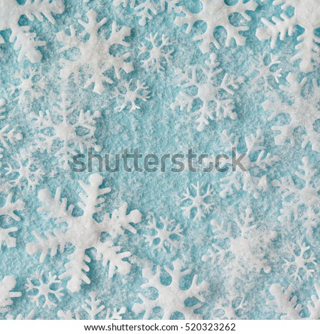 Winter pattern made of snowflakes on blue background. Winter concept. Flat lay.