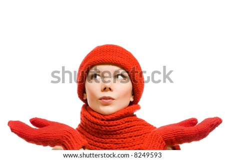 winter portrait of a beautiful young woman in red hat