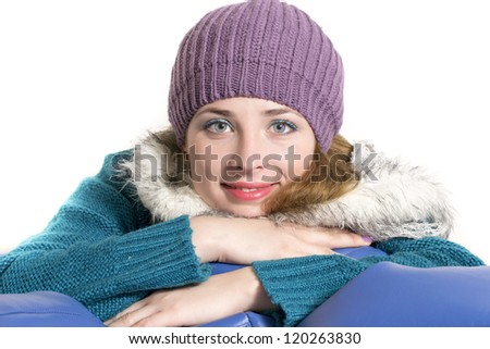Winter portrait of a young woman smiling. Copy space.