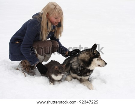 winter portrait of young woman with her cat and Eskimo dog on white background
