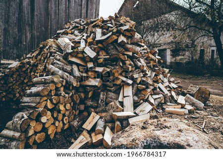 Winter preparation. Stacking Firewood. Pile of firewood loggs. Firewood background. ストックフォト ©