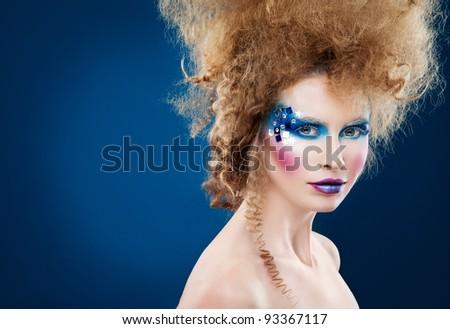 Winter Queen portrait of beauty woman with creative winter makeup