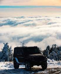 Winter ravel concept with 4x4 car. Offroad winter car. Adventure travel. Off-road travel on snow mountain road