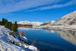 Winter reflections, Ashburton lakes, Canterbury, New Zealand