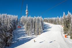 Winter resort with ski lift and ski tracks and the Snejanka tower -  Pamporovo, Bulgaria