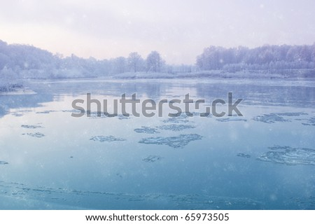 Winter River During Snowfall