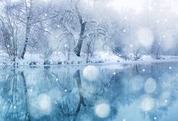 winter river in snowfall