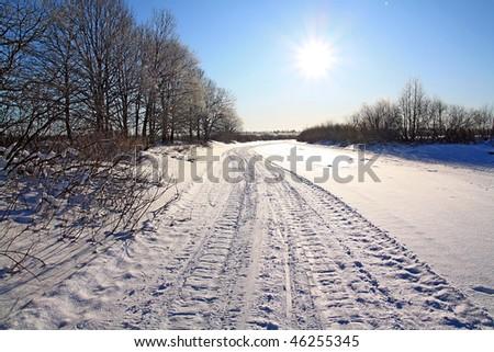 winter road against sun