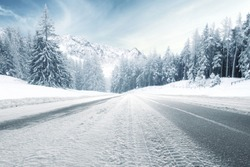 winter road and trees with snow and alps landscape